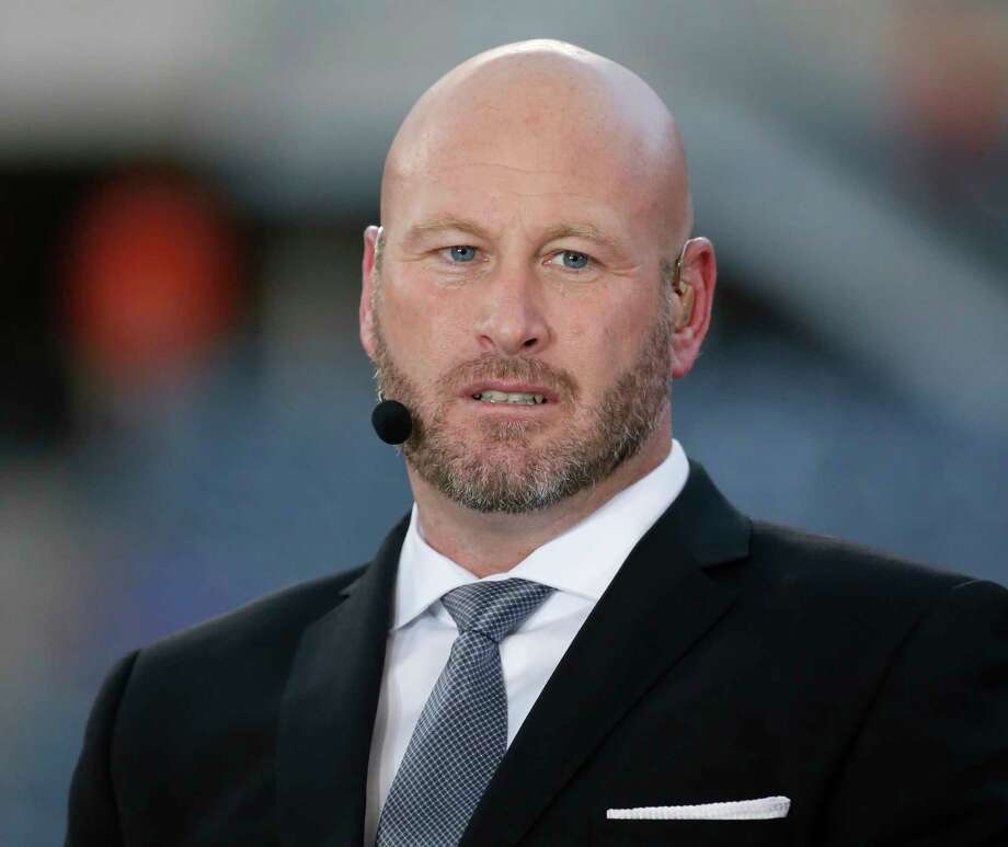 """FILE - In this Sept. 19, 2016, file photo, Trent Dilfer talks during ESPN's """"Monday Night Countdown"""" before an NFL football game between the Chicago Bears and the Philadelphia Eagles, in Chicago. ESPN is laying off about 100 employees, including former athletes-turned-broadcasters Trent Dilfer, Len Elmore and Danny Kanell, in a purge designed to focus the sports network on a more digital future. The cuts will trim ESPN's stable of on-air talent and writers by about 10 percent. (AP Photo/Charles Rex Arbogast, File) Photo: Charles Rex Arbogast, STF / Copyright 2017 The Associated Press. All rights reserved."""