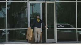"A man wearing a shirt that reads ""FBI Evidence Response Team"" walks Wednesday April 26, 2017 into the building located at 415 Embassy Oaks in San Antonio. A placard in front of the building was identified with the word ""Dannenbaum."" According to the Laredo Morning Times website, the FBI has raided some city and county buildings in Laredo as well as Dannenbaum Engineering."