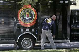 A man prepares to open an FBI truck near a Dannenbaum Engineering office. The FBI carried out raids across Texas, including at Dannenbaum offices in San Antonio and three other cities.