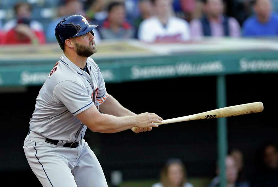 Houston Astros' Evan Gattis watches his two-run home run off Cleveland Indians starting pitcher Trevor Bauer during the fourth inning of a baseball game, Wednesday, April 26, 2017, in Cleveland. Carlos Correa scored on the play. (AP Photo/Tony Dejak) Photo: Tony Dejak, STF / AP 2016