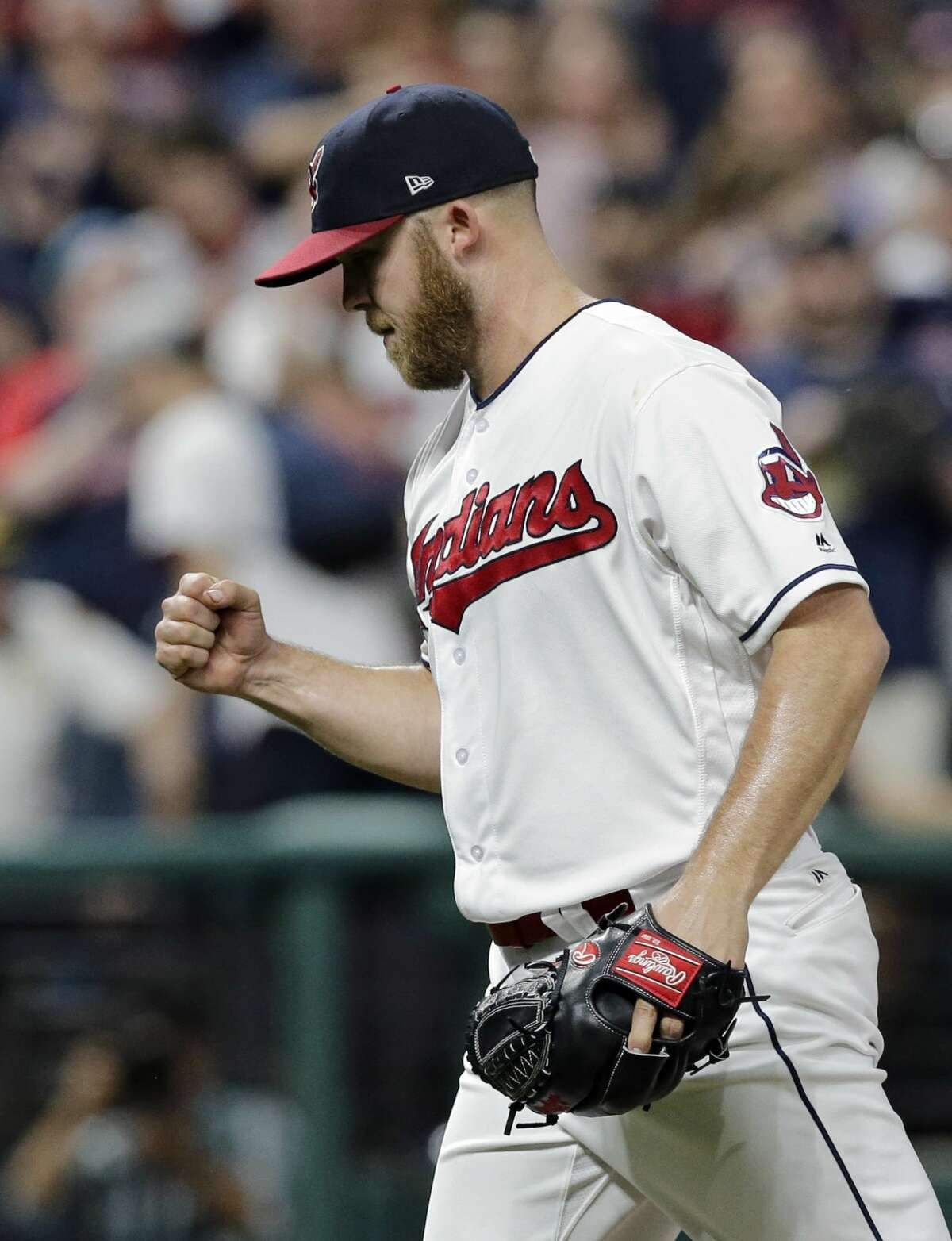 Cleveland Indians relief pitcher Cody Allen pumps his fist after the Indians defeated the Houston Astros 7-6 in a baseball game, Wednesday, April 26, 2017, in Cleveland. (AP Photo/Tony Dejak)