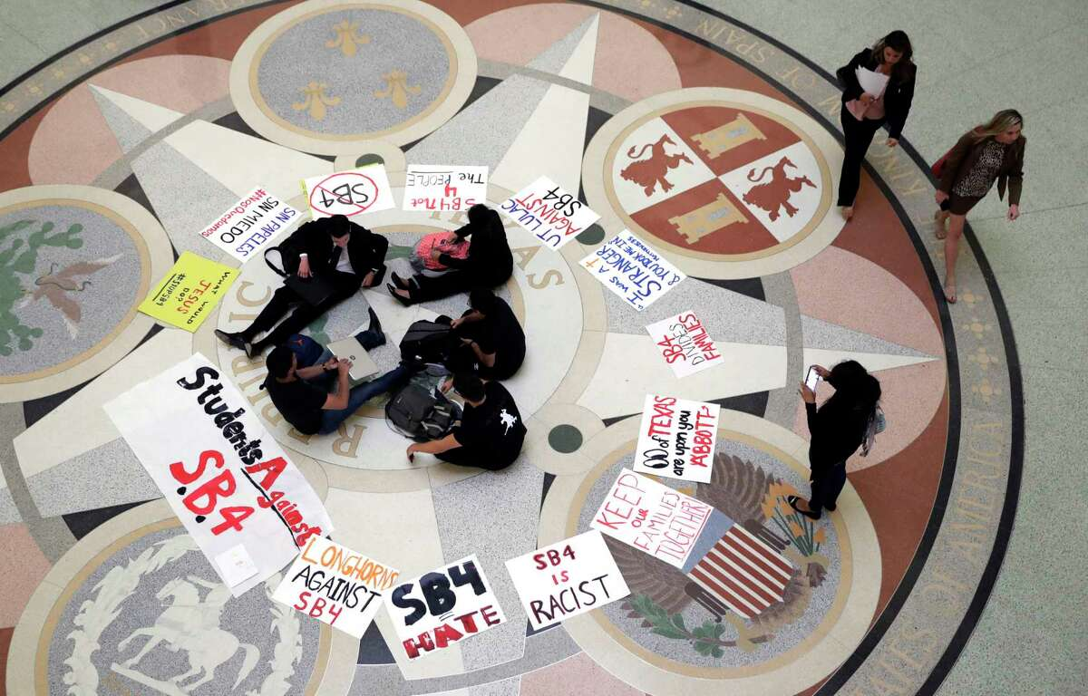 Students gather in the Rotunda at the Texas Capitol to oppose SB 4, an anti-