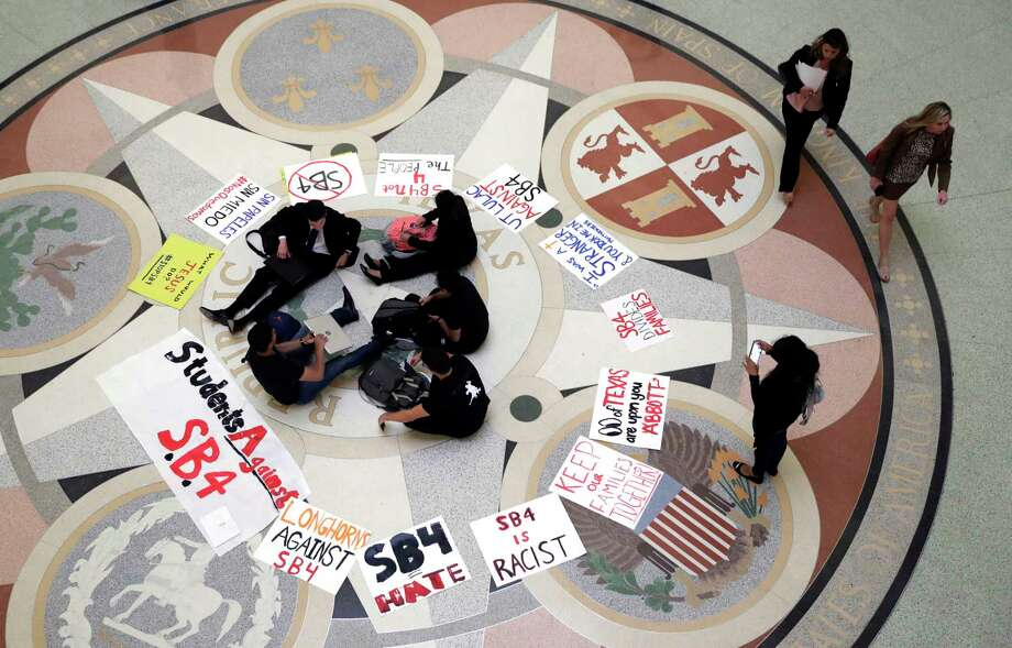 "Students gather in the Rotunda at the Texas Capitol to oppose SB 4, an anti-""sanctuary cities"" bill that has already cleared the Texas Senate. Photo: Eric Gay, STF / Copyright 2017 The Associated Press. All rights reserved."