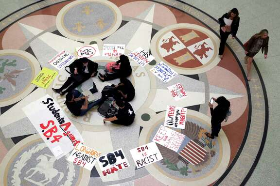 "Students gather in the Rotunda at the Texas Capitol to oppose SB 4, an anti-""sanctuary cities"" bill that has already cleared the Texas Senate."