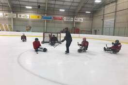 Disabled veterans joined STRIDE's sled hockey team, the Sled Warriors, in a professional clinic on Saturday, April 22, 2017, at the Albany County Hockey Facility in Colonie. Sled hockey players use a specially designed sled that sits on top of two hockey skate blades. (Courtesy of STRIDE Adaptive Sports)