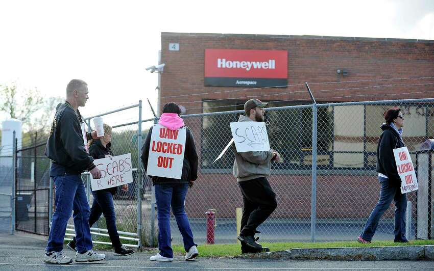 Honeywell workers picket outside the plant after the company locked out the workers early Monday morning, May 9, 2016, in Green Island, N.Y. The workers, part of the United Auto Workers union, voted down the company's last best offer on Saturday. (Paul Buckowski / Times Union archive)