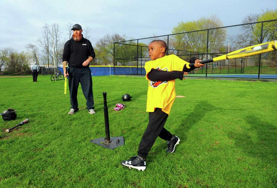 As coach Pat Magoon watches, Jasiah Young, 6, gets a big hit as he practices with his teammates in the Black Rock Little League T-Ball team the Red Wings at Ellsworth Park in Bridgeport, Conn. on Wednesday Apr. 26, 2017. The team will be facing the Mud Cats at the park on Saturday morning at 9:30. Photo: Christian Abraham / Hearst Connecticut Media / Connecticut Post