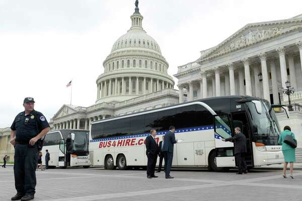 Sen. John Kennedy, R-La., second from right, boards a bus on Capitol Hill in Washington, Wednesday, April 26, 2017, heading to the White House with other Senators to get a briefing on North Korea. (AP Photo/Susan Walsh) ORG XMIT: DCSW120