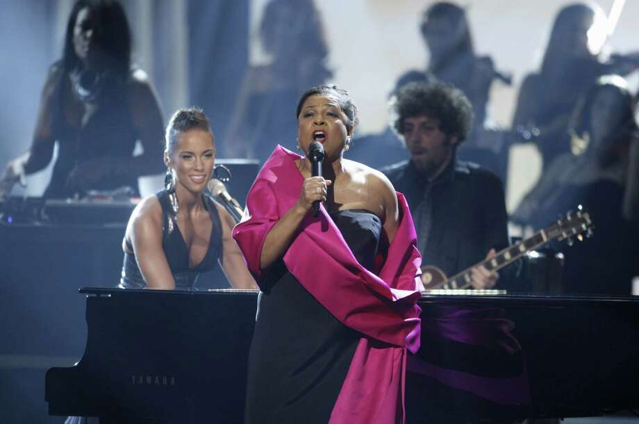 FILE - In this Nov. 23, 2008 file photo, Alicia Keys, left, performs with Kathleen Battle at the American Music Awards in Los Angeles. A Broadway producer has admitted scamming his friends and others into investing more than $165,000 in a nonexistent play about opera star Battle supposedly starring Oscar winner Lupita Nyong'o. Roland Scahill pleaded guilty in New York on Wednesday, April 26, 2017, to grand larceny and fraud charges. (AP Photo/Matt Sayles, File) Photo: Matt Sayles, STF / Copyright 2017 The Associated Press. All rights reserved.