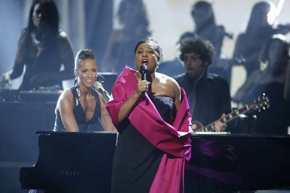 FILE - In this Nov. 23, 2008 file photo, Alicia Keys, left, performs with Kathleen Battle at the American Music Awards in Los Angeles. A Broadway producer has admitted scamming his friends and others into investing more than $165,000 in a nonexistent play about opera star Battle supposedly starring Oscar winner Lupita Nyong'o. Roland Scahill pleaded guilty in New York on Wednesday, April 26, 2017, to grand larceny and fraud charges. (AP Photo/Matt Sayles, File)