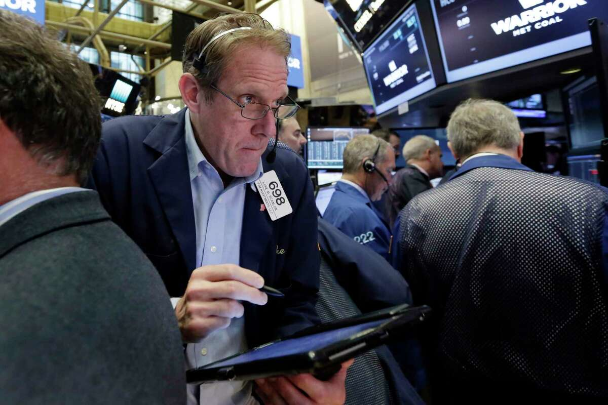 Trader Luke Scanlon works on the floor of the New York Stock Exchange, Wednesday, April 26, 2017. Stock markets around the world made only modest moves on Wednesday, waiting to see what the White House has in store for U.S. tax policy. (AP Photo/Richard Drew)