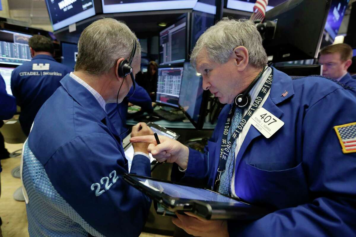 Traders Timothy Nick, left, and Richard Newman work on the floor of the New York Stock Exchange, Wednesday, April 26, 2017. Stock markets around the world made only modest moves on Wednesday, waiting to see what the White House has in store for U.S. tax policy. (AP Photo/Richard Drew)