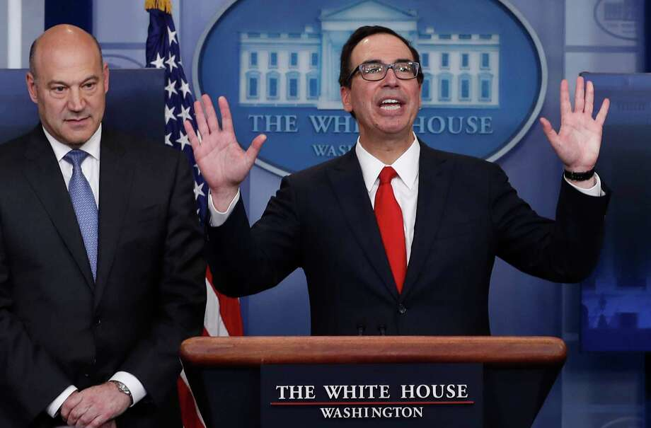 Treasury Secretary Steven Mnuchin, right, joined by National Economic Director Gary Cohn, speaks in the briefing room of the White House in Washington, Wednesday, April 26, 2017. President Donald Trump is proposing dramatically reducing the taxes paid by corporations big and small in an overhaul his administration says will spur economic growth and bring jobs and prosperity to the middle class. (AP Photo/Carolyn Kaster) Photo: Carolyn Kaster, STF / Copyright 2017 The Associated Press. All rights reserved.