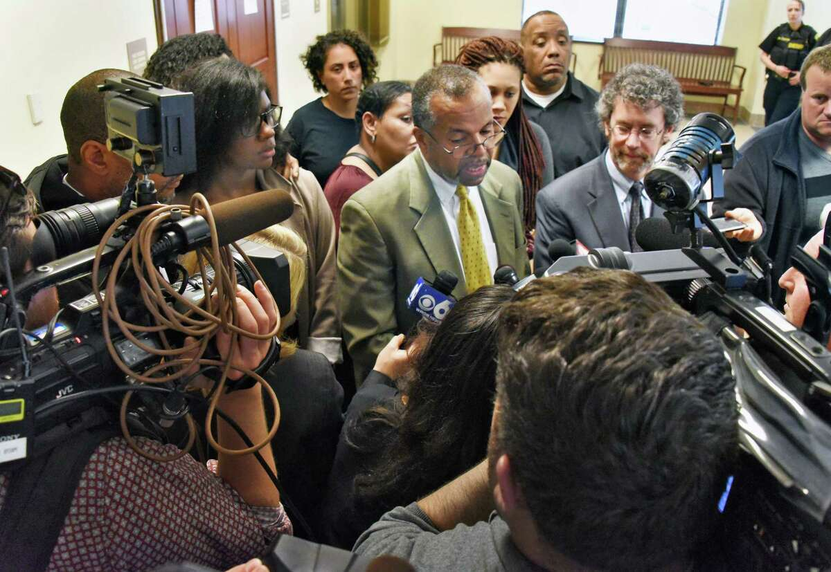 Reporters crowd around Asha Burwell, her attorney Fred Brewington, Ariel Agudio, and her attorney Mark Mishler, after a jury found them guilty of false reporting but not guilty of assault Wednesday April 26, 2017 in Albany,NY. (John Carl D'Annibale / Times Union)