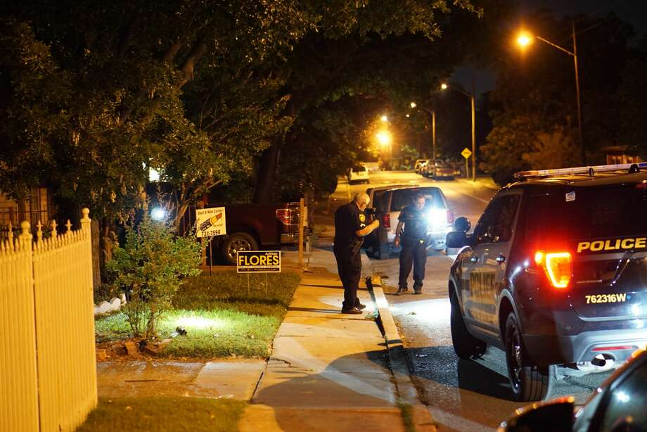 San Antonio Police Department investigators look for shotgun shell casings Wednesday night, April 26, in the 1600 block of West Olmos Drive. A resident fired three shots at a driver who threatened him with a gun, police said. Photo: Jacob Beltran