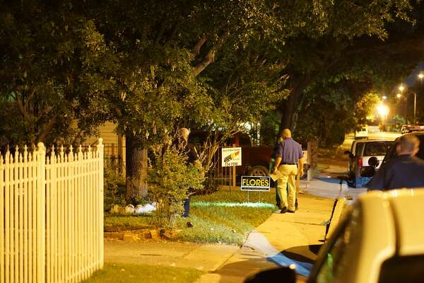 San Antonio Police Department investigators look for shotgun shell casings Wednesday night, April 26, in the 1600 block of West Olmos Drive. A resident fired three shots at a driver who threatened him with a gun, police said.