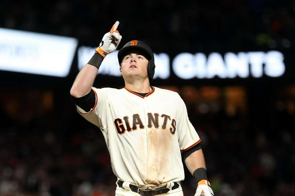 San Francisco Giants' Christian Arroyo celebrates his a 2-run home run in 7th inning against Los Angeles Dodgers' Sergio Romo during MLB game at AT&T Park in San Francisco, Calif., on Wednesday, April 26, 2017.