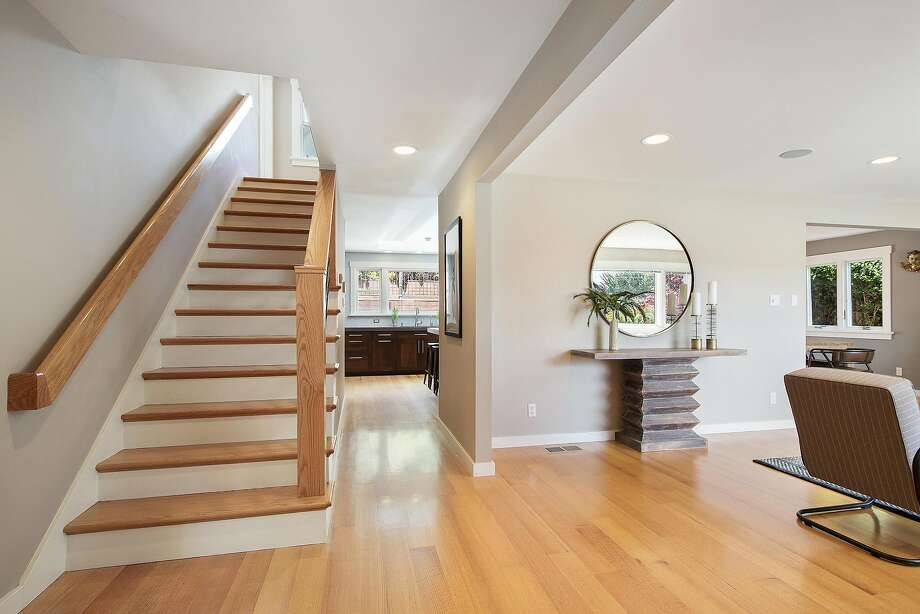 The home opens to a gracious living room and staircase to the bedroom level. Photo: Open Homes Photography