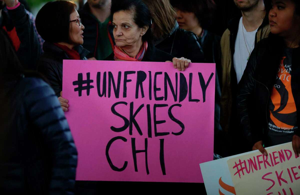 Demonstrators protest United Airlines at O'Hare International Airport on April 11, 2017 in Chicago, Illinois. The protest was in response to airport police officers physically removing passenger Dr. David Dao from his seat and dragging him off the airplane, after he was requested to give up his seat for United Airline crew members on a flight from Chicago to Louisville, Kentucky Sunday night. / AFP PHOTO / Joshua LOTTJOSHUA LOTT/AFP/Getty Images