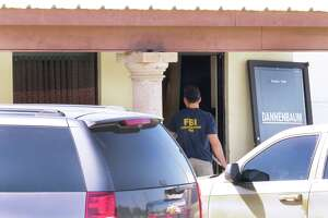 A member of the FBI Evidence Response Team enters the Dannenbaum Engineering offices at 8610 McPherson Road, Suite 130, Wednesday, April 26, 2017, where FBI and Texas Department of Public Safety personnel conducted an investigation.