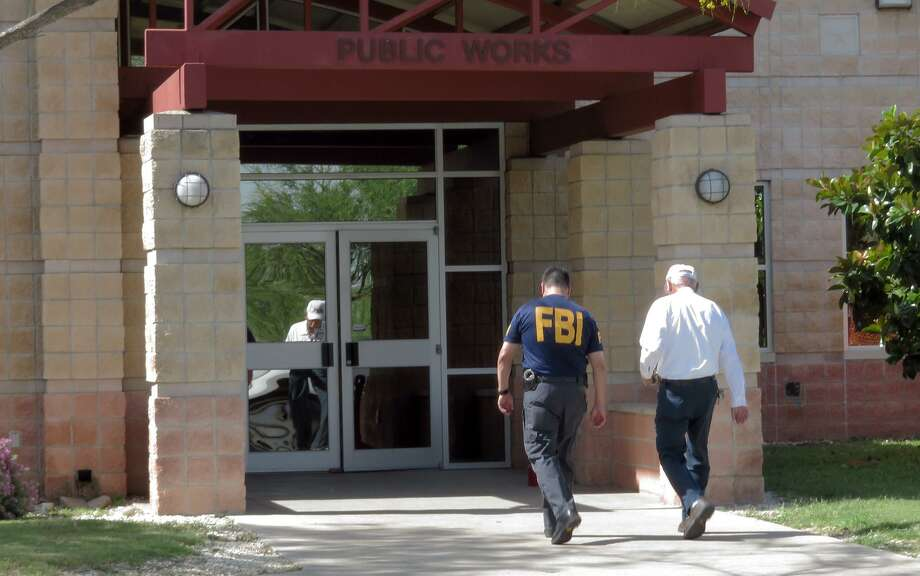 A man is escorted into the Public Works department offices by an FBI agent Wednesday, April 26, 2017 after FBI and Texas Department of Public Safety personnel closed the offices. Photo: Cuate Santos / Laredo Morning Times / Laredo Morning Times