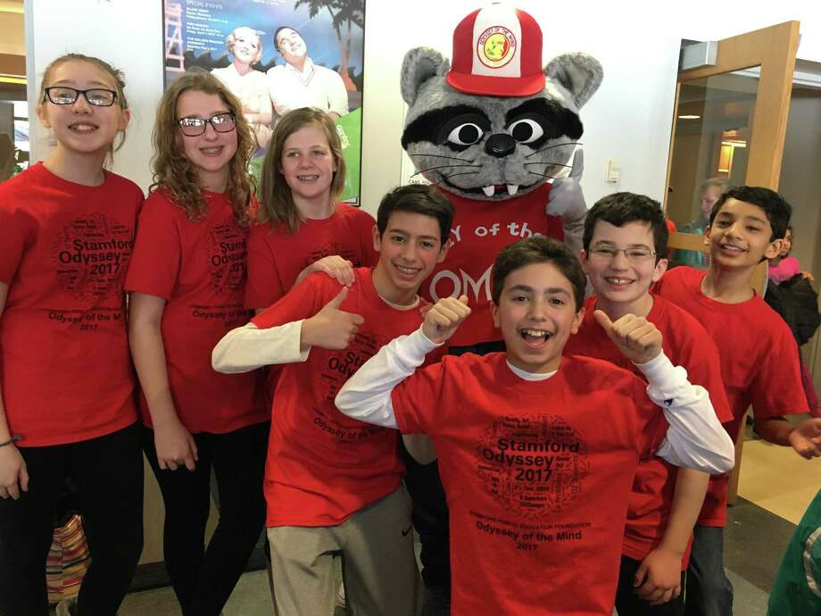 From left, Stamford Mixed Middle School students Grace Tolla, Grace Huber, Lucia Kempton, Anthony Fabricatore, Max Guttman, Jackson Saucedo and Rohan Sarma pose for a picture with the mascot Omer at the Odyssey of the Mind statewide tournament at Southern Connecticut State University in New Haven, Conn., on March 18, 2017. Photo: Contributed