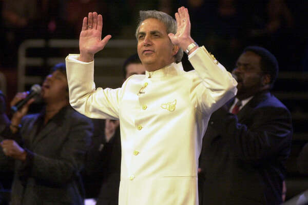 Orange, Feb. 27, 2003 ––– Faith healer Benny Hinn during his Miracle Crusade at the Arrowhead Pond of Anaheim. These Miricle Crusade attracted thousands people with health problems who want to be healed by Hinn. (Photo by Irfan Khan/Los Angeles Times via Getty Images)