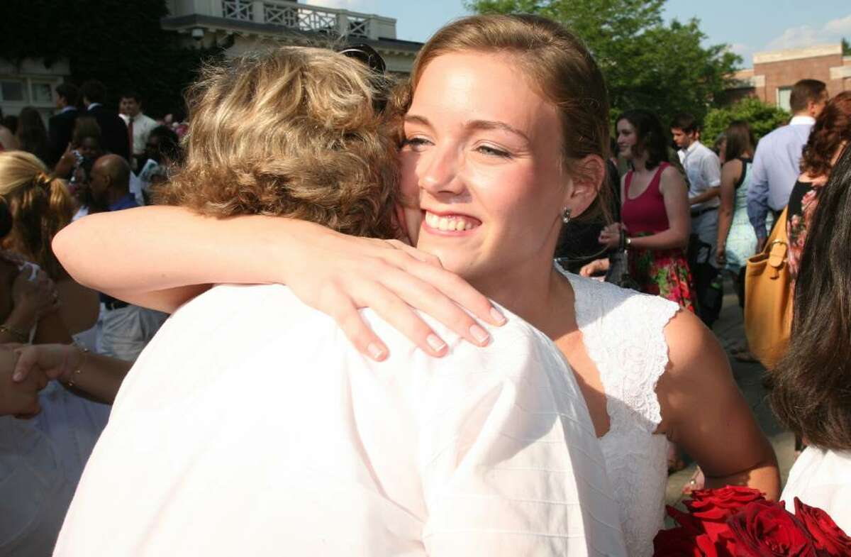 2010 Convent of the Sacred Heart graduate Kimberly Sebastian gets a hug from history and psychology teacher Anne DeSutter at the end of Friday afternoon's commencement ceremony.