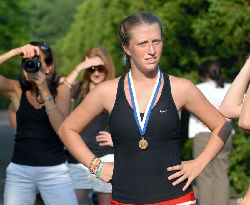 Kate Mannelly of New Canaan wears her Class M Champions medals after New Canaan deafeated Wilton High School for the State titled 7-0, at Yale University, June 4, 2010.