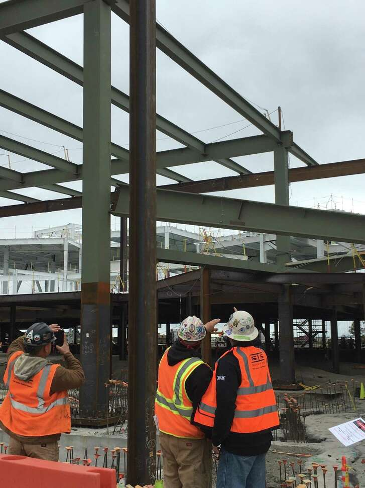 Two men were badly injured and transported to the hospital after falling nearly 20 feet at Facebook's under-construction Building 21 in Menlo Park, authorities said.