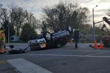 The intersection of Saginaw and Sugnet roads was closed for about an hour this morning after a crash. The crash, involving a small white pickup truck and a black Chevrolet Silverado, left the Chevy upside down in the intersection.