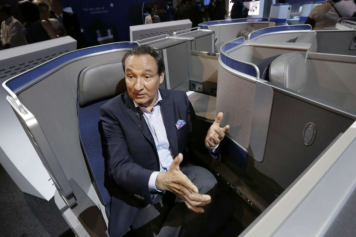 FILE - In this Thursday, June 2, 2016, file photo, United Airlines CEO Oscar Munoz speaks during an interview in New York, while seated in the seating configuration of the carrier's new Polaris service. United Airlines says it will raise the limit to $10,000 on payments to customers who give up seats on oversold flights and will increase training for employees as it deals with fallout from the video of a passenger being violently dragged from his seat. Munoz said his response, in which he blamed the passenger and supported his employees, was