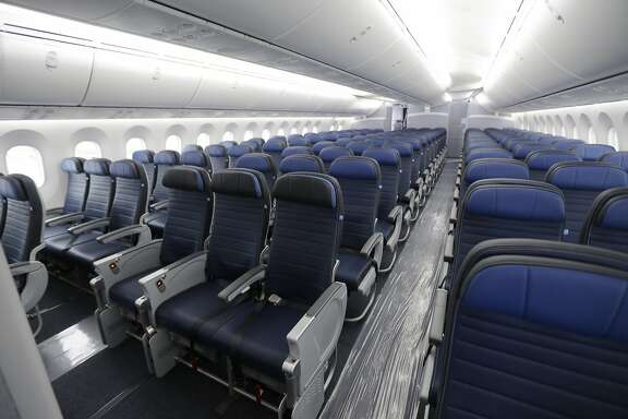 FILE - This Jan. 26, 2016, file photo, shows economy class seating on a new United Airlines Boeing 787-9 undergoing final configuration and maintenance work at Seattle-Tacoma International Airport in Seattle. United Airlines says it will raise the limit to $10,000 on payments to customers who give up seats on oversold flights and will increase training for employees as it deals with fallout from the video of a passenger being violently dragged from his seat. (AP Photo/Ted S. Warren, File)