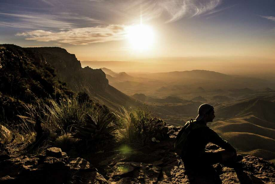 Vipul Devluk takes in the sunrise from the South Rim at Big Bend National Park on April 10, 2017. Photo: Michael Ciaglo /Houston Chronicle / Michael Ciaglo