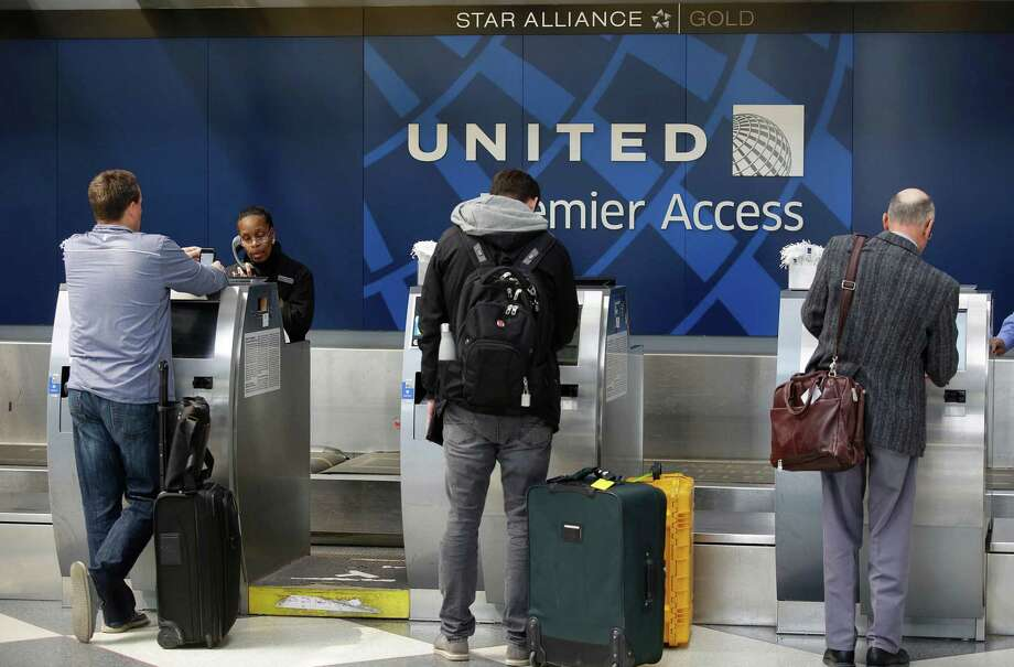 "United Airlines has announced it will offer bumped passengers up to $10,000 in compensation and reduce overbooking following the dragging incident on board one of its flights that caused worldwide outrage. Those and other changes, which the airline called ""substantial,"" are the result of a two-week internal probe of the April 9 incident, video of which went viral. Photo: Joshua Lott /AFP /Getty Images / AFP or licensors"