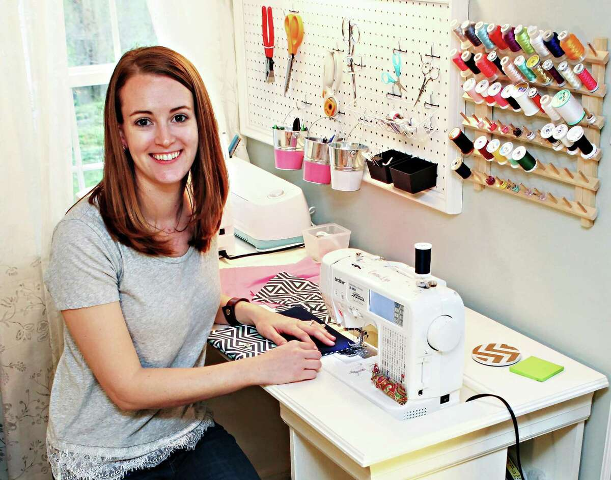Emma Kozlowski, owner of Emma Lyn Designs, works on some of her products at her Bethel, Conn., home, in this photo by Erin Kavanaugh Photography.