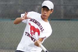 Memorial's Anthony Huynh returns the ball during a doubles match with Cinco Ranch.