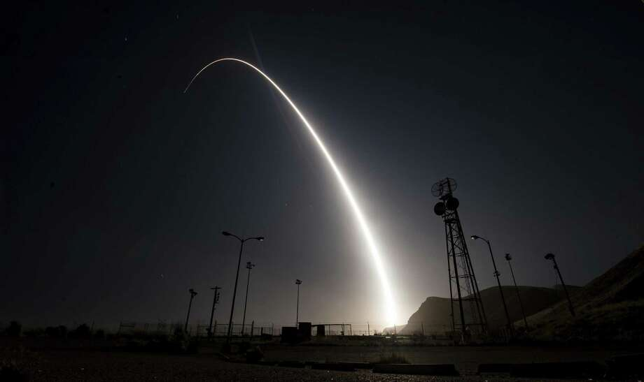 In an image taken with a slow shutter speed, an unarmed Minuteman 3 missile blasts off from Vandenberg AFB, Calif. Photo: U.S. Air Force /Associated Press / U.S. Air Force