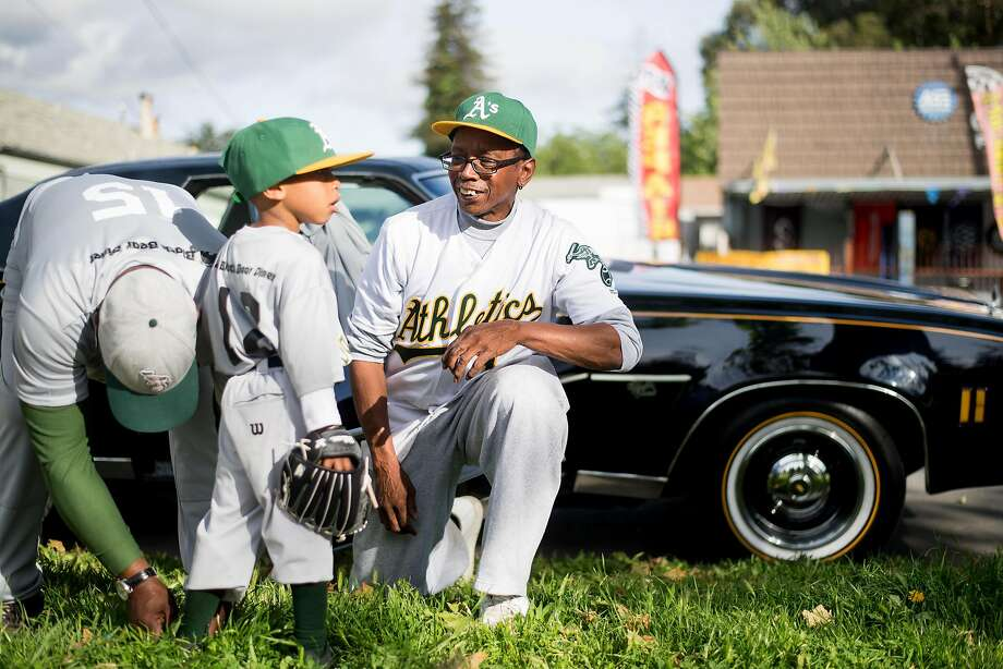 Roscoe Bryant Jr. (right), who started a baseball team for youths in West Oakland in 2004, talks with a player before practice. Photo: Noah Berger, Special To The Chronicle