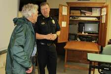Captain Thomas Conlan guides Wilton resident Jason Cutler on a tour of the Wilton Police Department a week before the town will vote on whether or not to fund a study to explore replacing the existing police station.