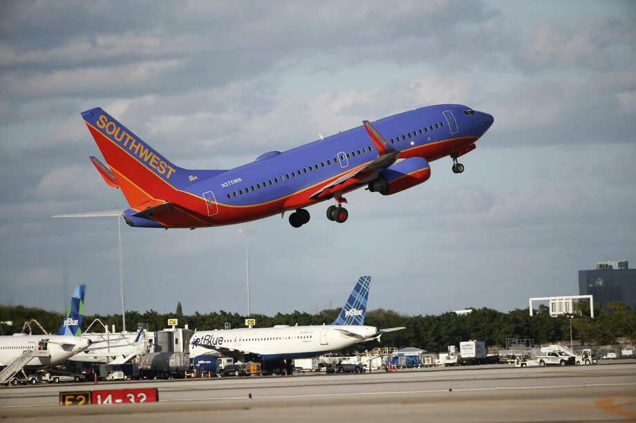 Southwest Airlines' first-quarter earnings fell 32 percent as it flew more passengers but took in less revenue on average from each one. Rising costs for fuel and labor weighed on the airline. Photo: Wilfredo Lee /Associated Press / Copyright 2017 The Associated Press. All rights reserved.