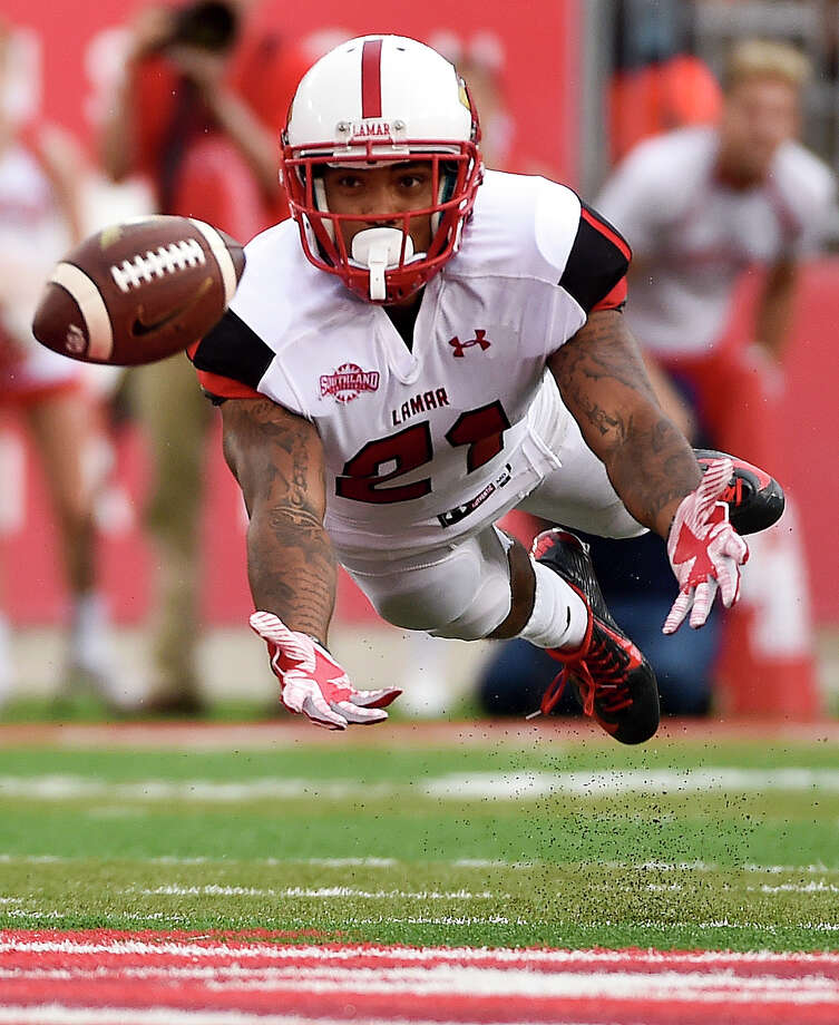 Lamar defensive back Brendan Langley attempts to intercept the pass of Houston quarterback Kyle Postma in the first half of an NCAA college football game, Saturday, Sept. 10, 2016, in Houston. (AP Photo/Eric Christian Smith) Photo: Eric Christian Smith, FRE / FR171023 AP