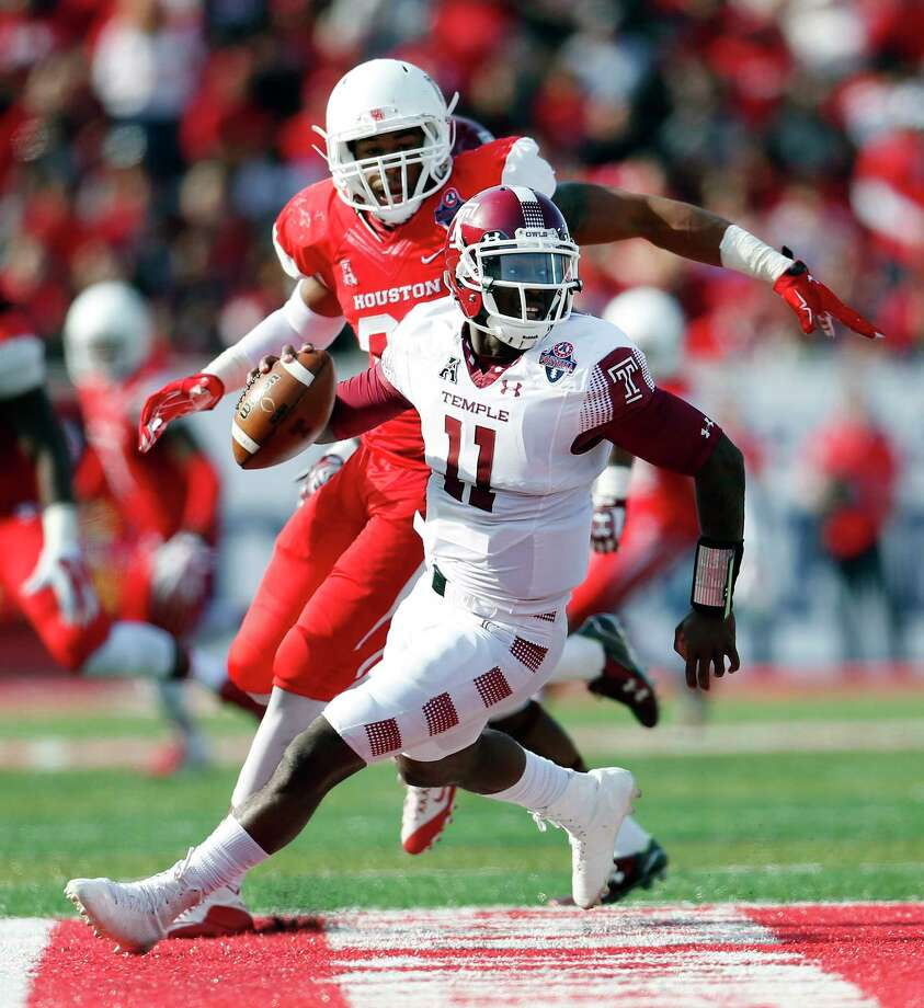 Temple Owls quarterback P.J. Walker (11) scrambles against the defense of Houston Cougars defensive end Cameron Malveaux (94) during the fourth quarter of the American Athletic Conference Championship football game at TDECU Stadium on Saturday, Dec. 5, 2015, in Houston   ( Karen Warren / Houston Chronicle ) Photo: Karen Warren, Staff / © 2015  Houston Chronicle