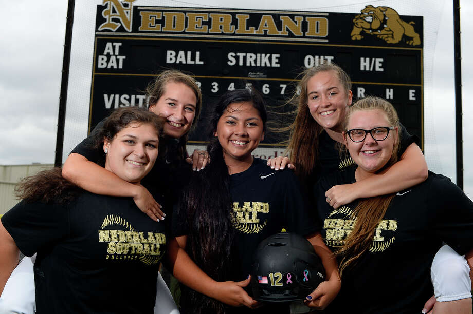 Nederland softball teammates, from left, Kassidy Litchfield, Jessica Saenz, Victoria Garza, Kara Litchfield and Bailey Beard have been friends since they were toddlers. Garza beat lymphoma when she was in sixth grade, but she was diagnosed with thyroid cancer in March and has had the support of the team behind her.  Photo taken Tuesday 4/25/17 Ryan Pelham/The Enterprise Photo: Ryan Pelham / ©2017 The Beaumont Enterprise/Ryan Pelham