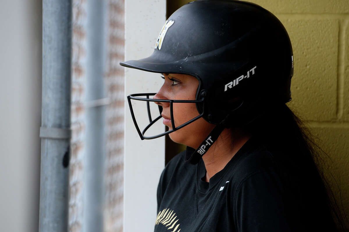 Nederland softball player Victoria Garza watches from the dugout during practice on Tuesday. Garza beat lymphoma when she was in sixth grade, but she was diagnosed with thyroid cancer in March. Photo taken Tuesday 4/25/17 Ryan Pelham/The Enterprise