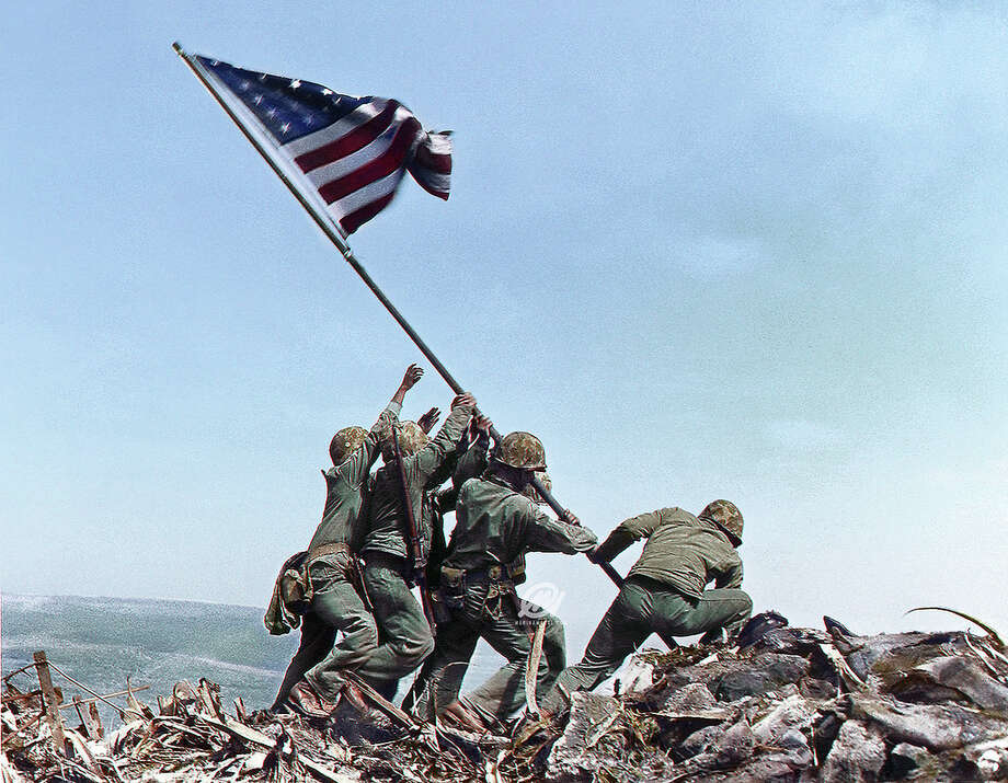 PHOTOS: The work of colorization artist Marina AmaralThis image of Marines raising the American flag on Iwo Jima on February 23, 1945 was colorized by Marina Amaral.Click through to see more images from history colorized by the Brazilian artist... Photo: Marina Amaral / Marinamaral.com