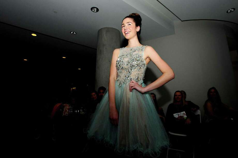Shaina Bond smiles while modeling a dress from Aziza Couture during Stamford Downtown's Fashion Night Out inside residential building 75 Tresser in downtown Stamford, Conn. on Wednesday, April 26, 2017. Photo: Michael Cummo / Hearst Connecticut Media / Stamford Advocate