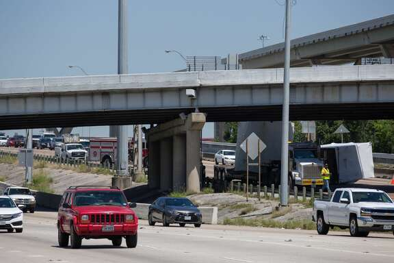 Motorists are stopped behind a wrecked big rig on the Hogan Street Overpass along I-45 North. on April 27, 2017. It appears the crash knocked off part of its cargo, shutting down nearly the entire southbound freeway.