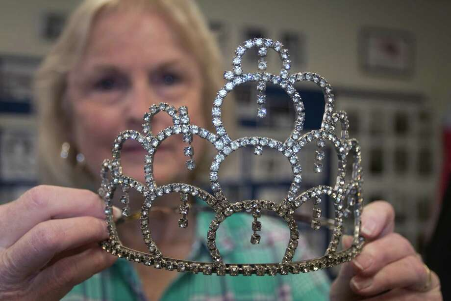 """Cheryl Bouillion holds a tiara from the Friendswood Schools Museum once worn by a Friendswood High School homecoming queen. """"I feel like it's so important to preserve where you came from,"""" says Bouillion, who helped plan the museum."""