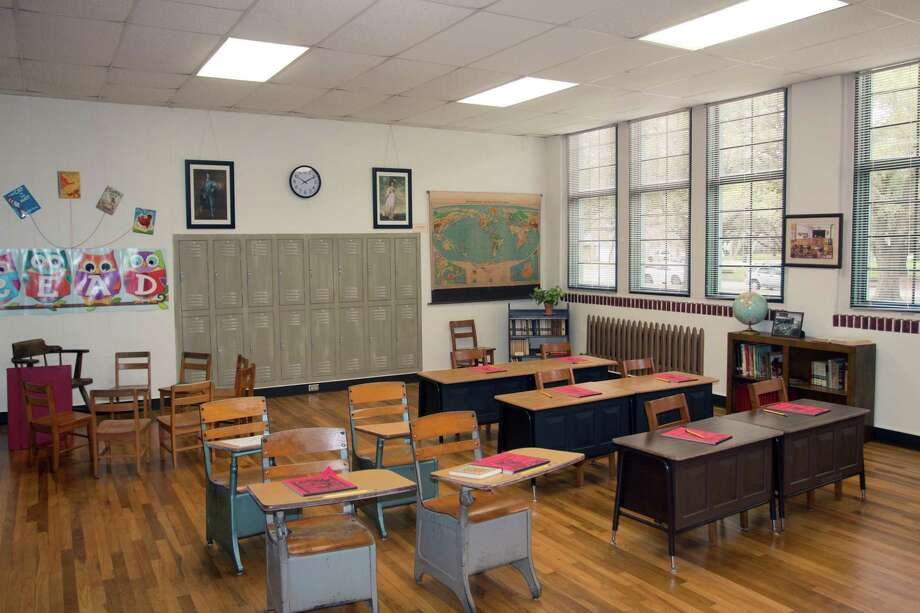 A vintage classroom setting is preserved at the Friendswood Schools Museum.